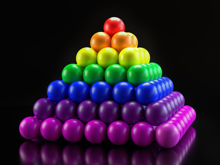 3D render of pyramid formed from balls in rainbow colors on black background