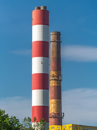 Closeup of heat and power generating plant chimneys Standard-Bild - 116230494