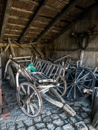 Old shed with farmstead wooden hayrack