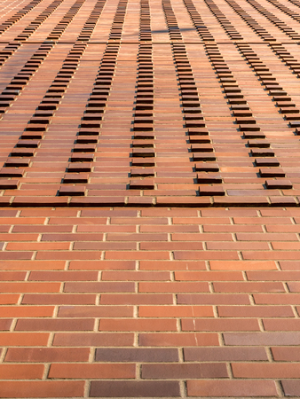 Background of red brick wall - converging perspective