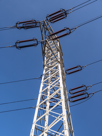 High voltage pylon shot from above over blue sky