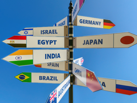 3D render of multidirectional roadsign with major countries and their flags over the sky Stock Photo
