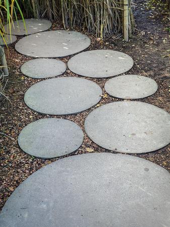 Circle concrete slab path in the garden