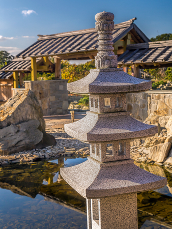 Typical Japanese rock garden with little shrine Stock Photo
