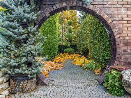 Circle brick wall gate in old garden