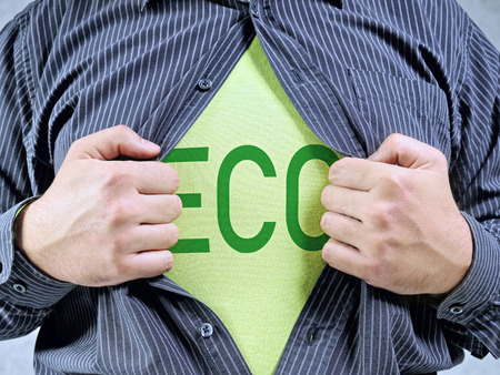 A man wearing shirt showing green ECO word imprinted on T-shirt underneath Stock Photo