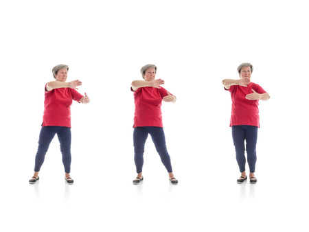 Series of basic Tai chi forms performed by older woman shot on white background 版權商用圖片