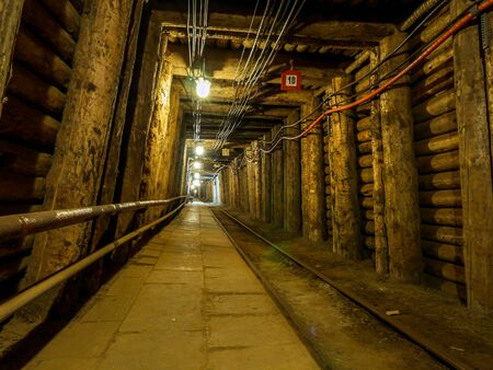BOCHNIA, POLAND - 4 MAY, 2013: Passanger train line in old salt mine in Bochnia Salt Mine, Poland