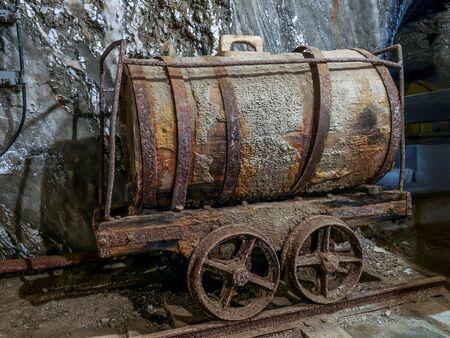 BOCHNIA, POLAND - 4 MAY, 2013: Old salt mine yellow train with bogies in Bochnia Salt Mine, Poland Redakční