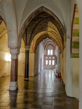 MALBORK, POLAND - 15 AUGUST, 2013: Gothic cloister of Teutonic Malbork castle, Poland. Malbork castle is the largest brick fortress in the world Redakční