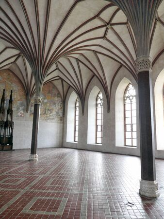 MALBORK, POLAND - 15 AUGUST, 2013: Gothic Great Refectory of Teutonic Malbork castle, Poland. Malbork castle is the largest brick fortress in the world