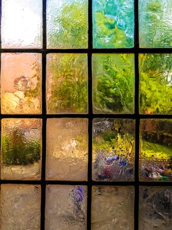 Closeup of colorful vintage muntin semitranslucent window panes