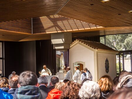 FATIMA, PORTUGAL - 6 APRIL, 2019:   Catholic Priest celebrating Mass at the Sanctuary of Fatima in Portugal Редакционное