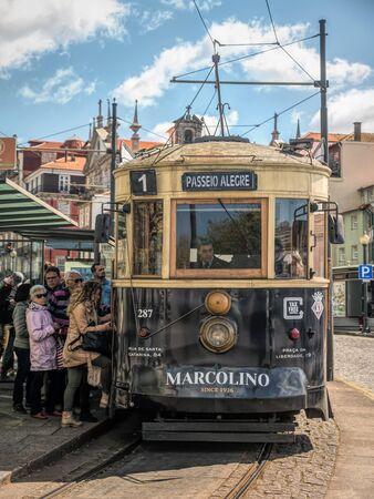 PORTO, PORTUGAL - 3 APRIL, 2019: Passengers entering historical street tram car, Porto, Portugal