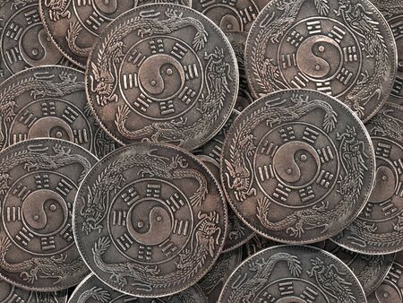 Pile of ancient chinese ying-yang symbol coins