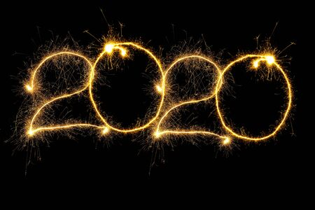 New Year 2020 arranged from sparking digits over black background