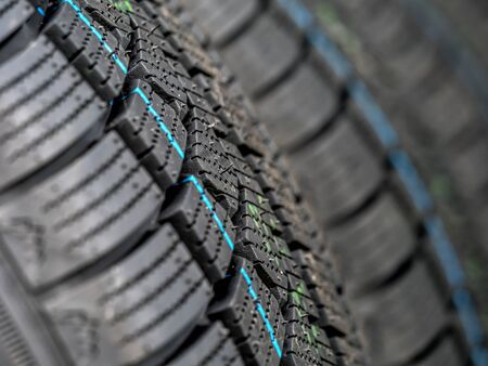 Closeup of row of new winter car tires
