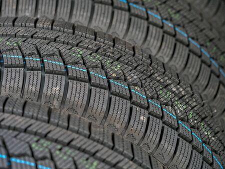 Closeup of row of new winter car tires