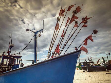 Fishermans boats docked at the sandy wharf - Miedzyzdroje beach, Poland Reklamní fotografie