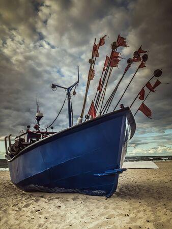 Fishermans boat docked at the sandy wharf - Miedzyzdroje beach, Poland Reklamní fotografie