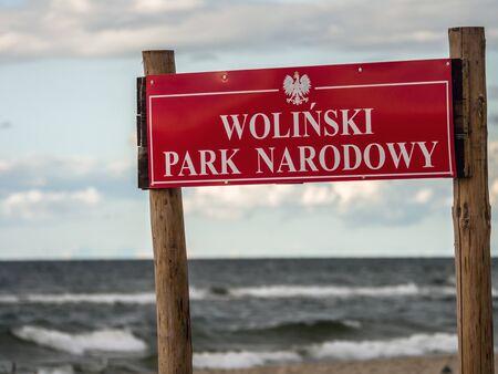 Wolin National Park sign, against Baltic Sea, Poland Reklamní fotografie