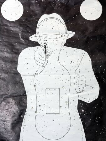 Paper silhouette shooting target with lots of bullet hits Stok Fotoğraf
