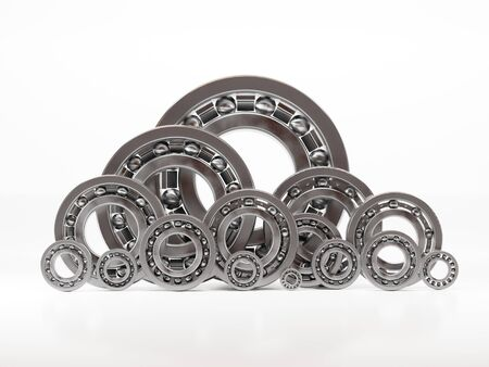 Set of different size and type of steel ball bearings on white background
