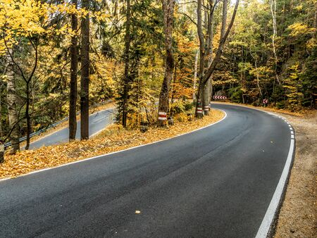 Picturesque the so called Hundred Curves Road in the Table Mountains National Park in autumn time, Poland Stock Photo