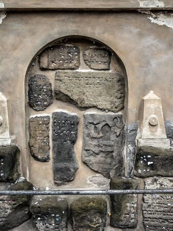 Fragment of Gothic Jewish tombstones with prayer sheets - old Jewish cemetery in Prague, Czech Republic