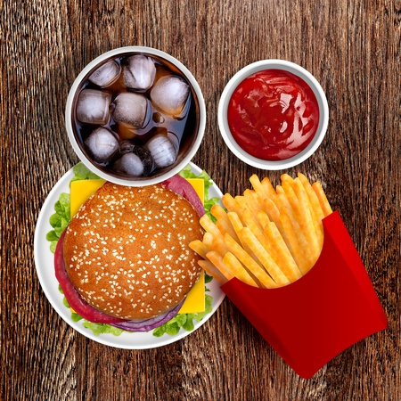 Delicious Cheeseburger with fresh tomato, lettuce and onion, with golden french fries and cold cola Stock Photo