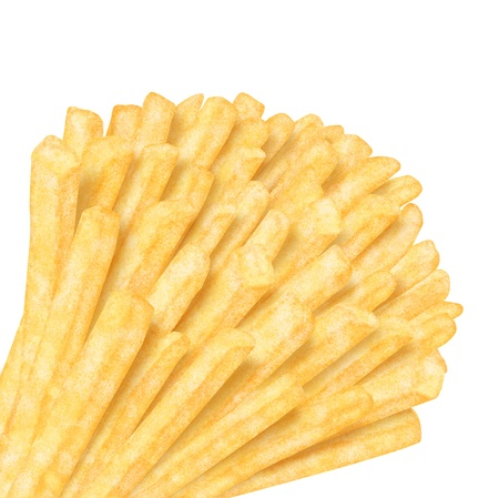 Bunch of french fries in the corner, on white background