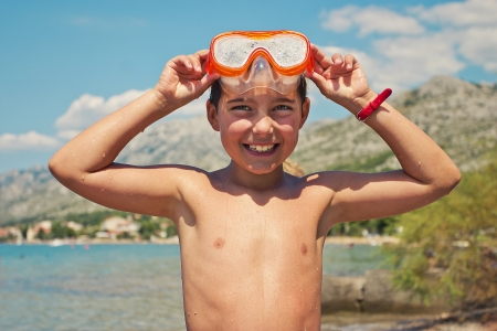 unclothed: Smiling boy with diving mask on the head Stock Photo