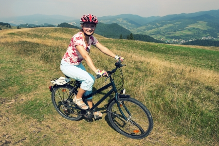 Woman on a bicycle in Pieniny National Park