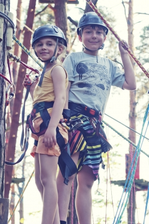 climbing sport: Girl and boy in adventure park Stock Photo