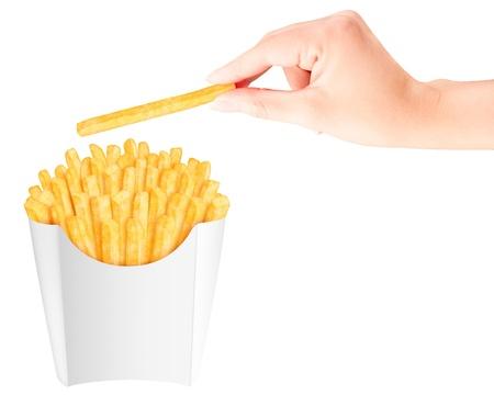 papas fritas: Francés fritas en el empaquetado con una mano que sostiene por encima