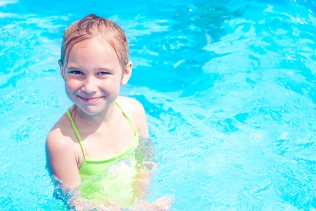unclothed: Little girl in swimming pool