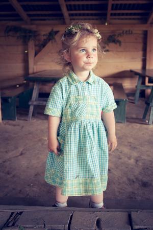 coronet: Little girl with wild flowers coronet on the head Stock Photo