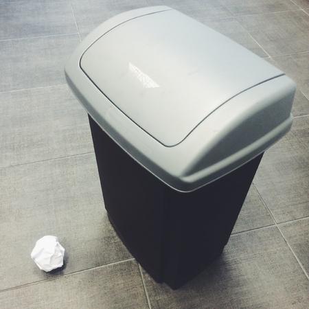 missed: Crumpled piece of paper next to rubbish bin