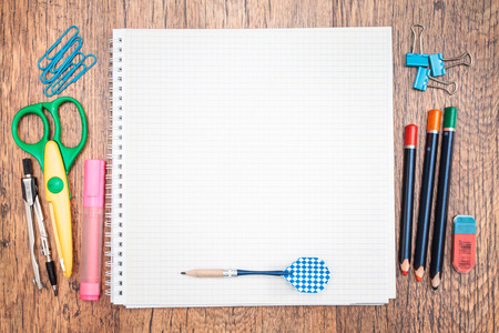 Top view of school accessories on a desk with copy space photo