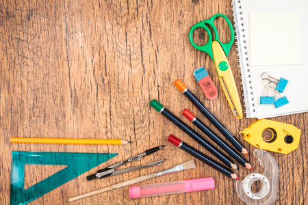 paper and pen: Top view of school accessories on a desk