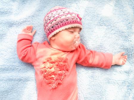 blue blanket: Little baby girl sleeping on blue blanket Stock Photo