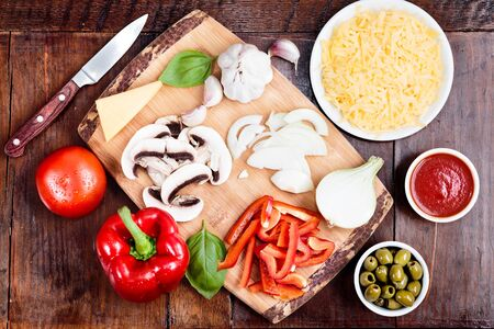 trencher: Ingredients of pizza put on trencher