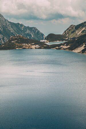 enclosing: Mountains enclosing the lakes