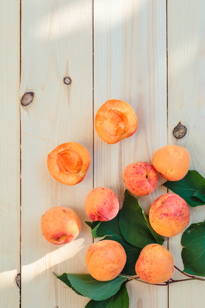 Fresh apricots straight from the garden on wooden table