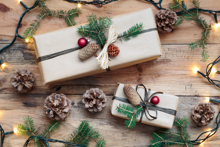 Wrapped Christmas presents on wooden floor Stock Photo