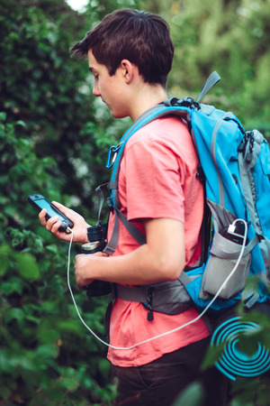 Charging mobile phone during the journey Stock Photo