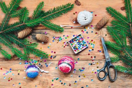 decoration: Making Christmas ball pinning the sequins onto the ball Stock Photo