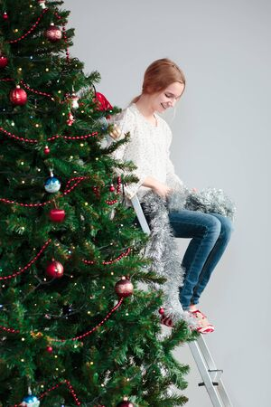 Young girl unwrapping Christmas decoration