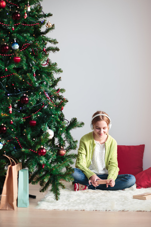 carols: Young girl listening to Christmas carols through her headphones in the early morning