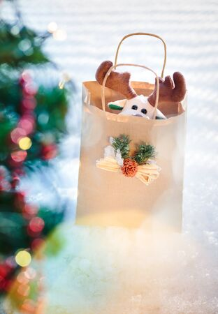 Reindeer toy in a paper bag for Christmas gift